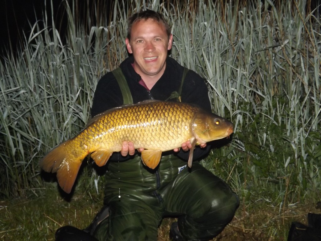 Jason Sheath with a 14lb Common from a lake near Weymouth